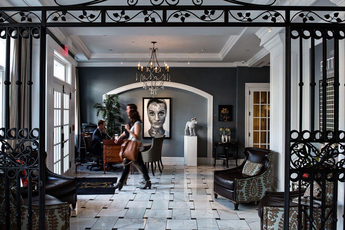 the lobby of an elegant art-centric hotel