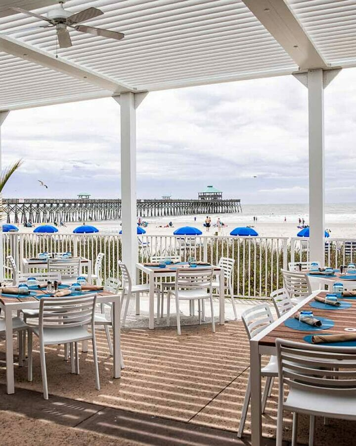 outdoor dining area at beachfront restaurant