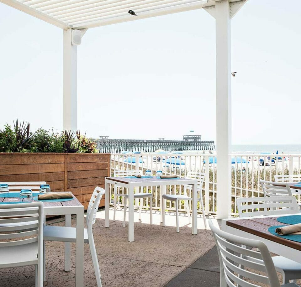 outdoor dining area at beachfront restaurant
