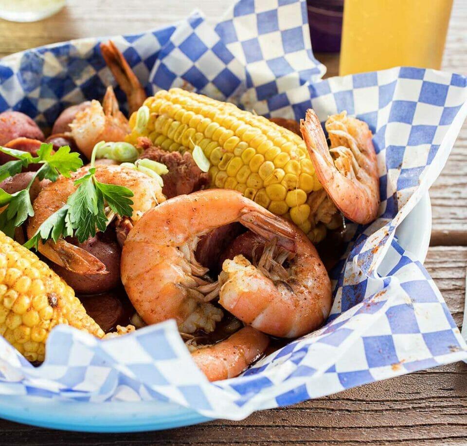 shrimp, corn on the cob and potato dish