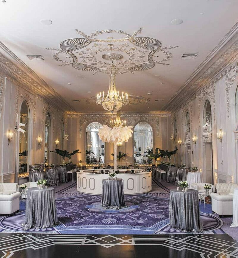 large, lavishly decorated event space set up for a gala