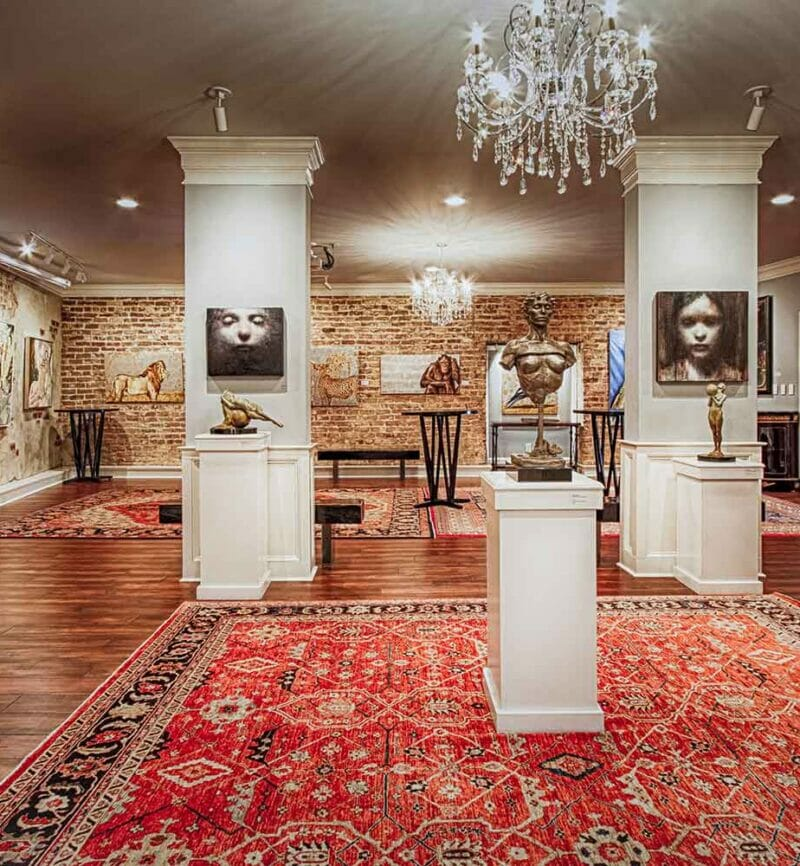 glamorus art covered event space with large floor rugs