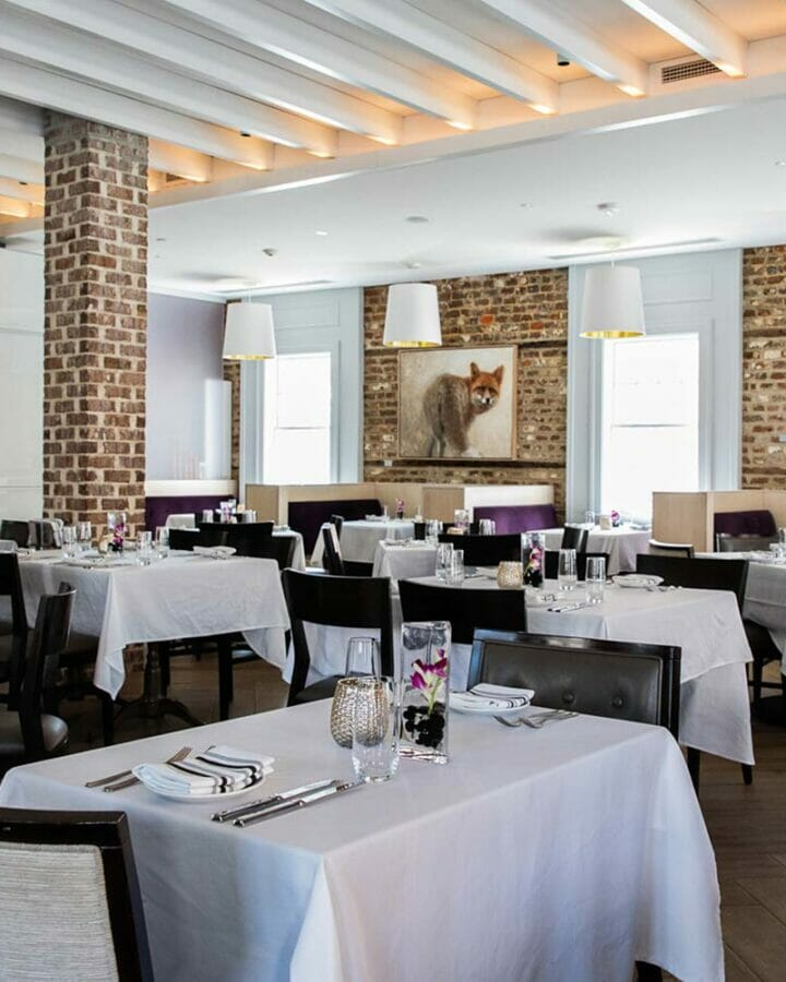 Interior dining room at restaurant with white tables