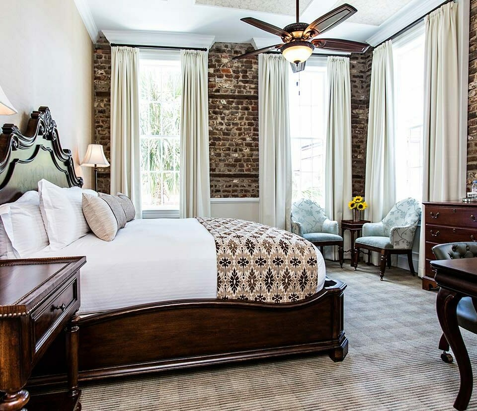king suite in brick wall hotel room