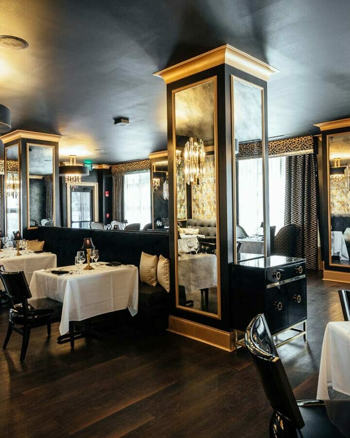 Interior dining room of Bridgeman's Chophouse with tables set for dinner service