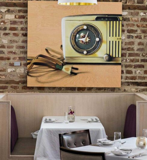 brick walls, retro radio artwork and dining restaurant booth