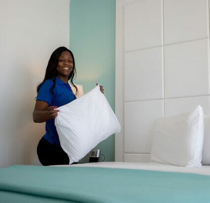 woman cleaning hotel room