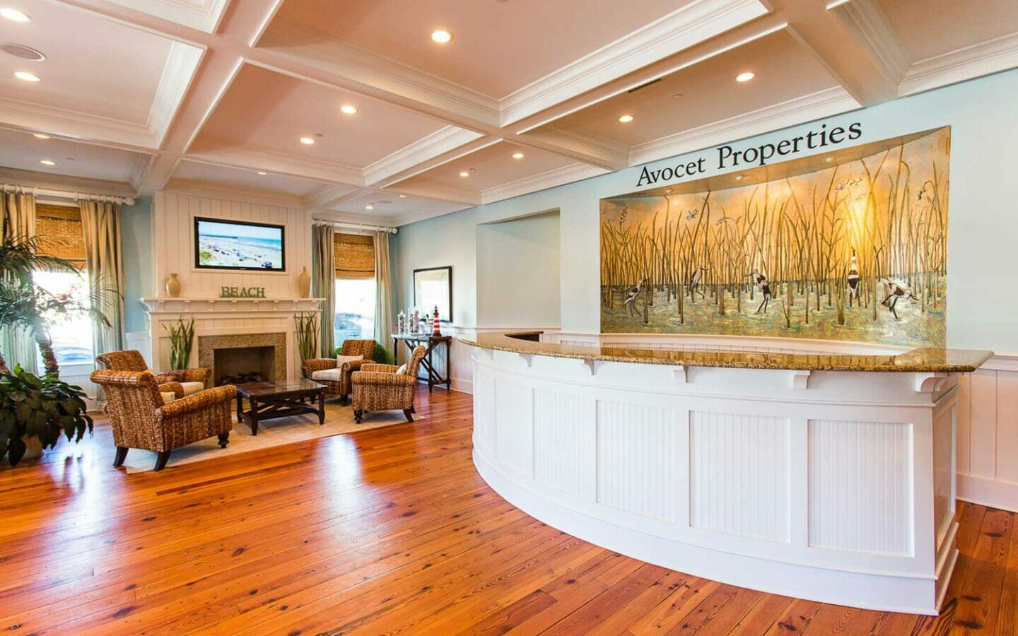 front desk in lobby of Avocet Properties with a sitting area beside a fireplace