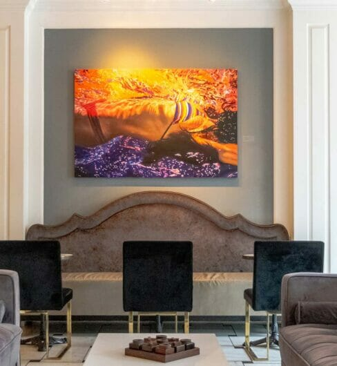 dining area in The Drawing Room with comfortable seating a large piece of original artwork on the wall
