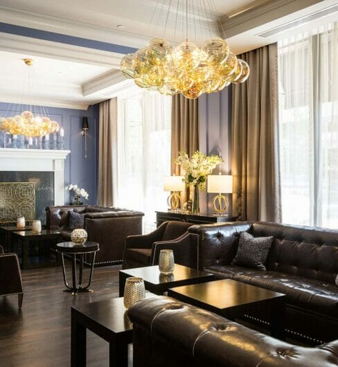lobby bar lounge with leather couches and large chandelier